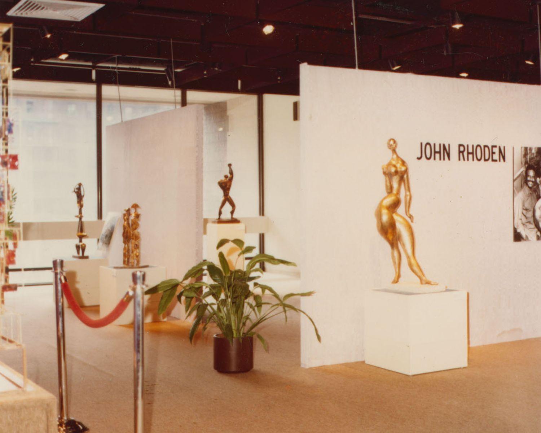 John posing with sculpture